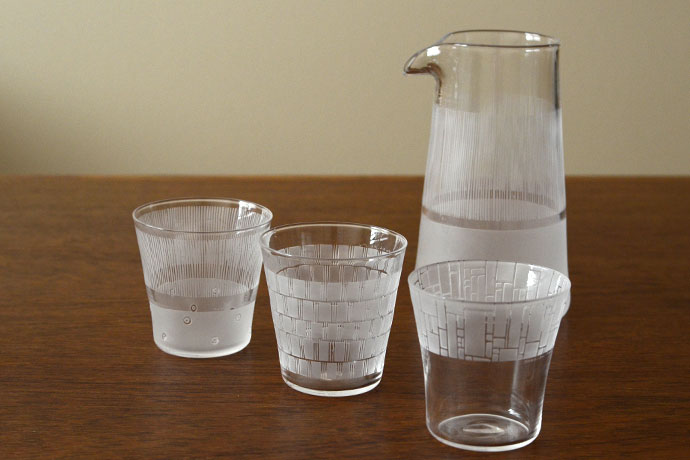 A blown and etched glass carafe and cups by Japanese glassmaker Nitta Yoshiko