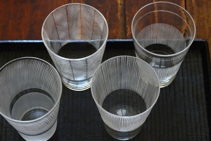 Cups by Nitta Yoshiko. The beautiful contrast of etched and clear elements emphasize the transparency of glass