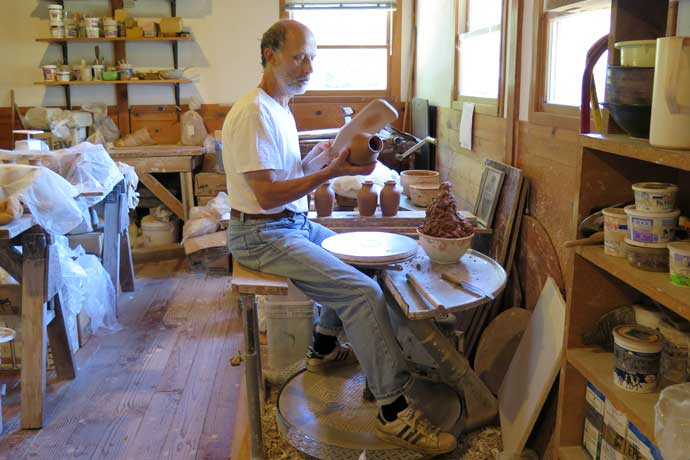 Potter Kenneth Pincus at a kick wheel in his studio in Oregon