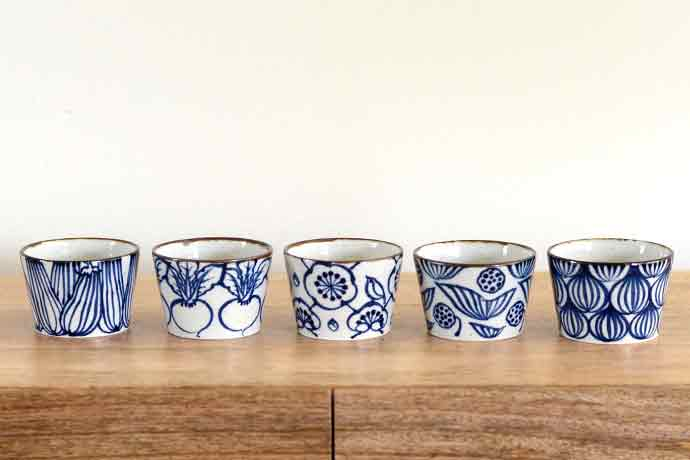 Blue-and-White cups by Japanese potter Watanabe Ai. She gets inspiration from everyday objects