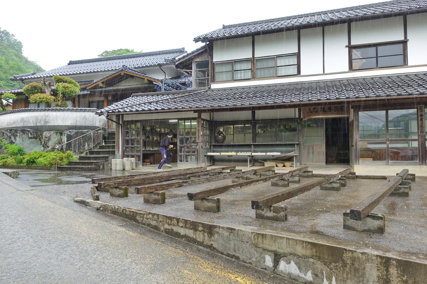 The front of the Sakamoto Yoshitaka kiln in Onta during a heavy downpour. On a sunny day, the pots will be drying out in the front.